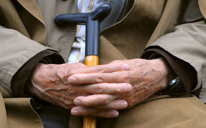 Pensioner with cane