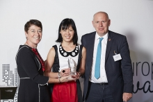 Back and Middle Office Provider - SimCorp. Accepted by Sylvia Kwok and Wayne Vinton, presented by Catherine Doherty.