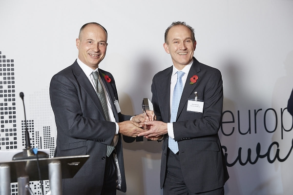 CIO of the Year - Nick Mustoe, Invesco Perpetual. Accepted by Dean Newman, presented by Philippe Lespinard.